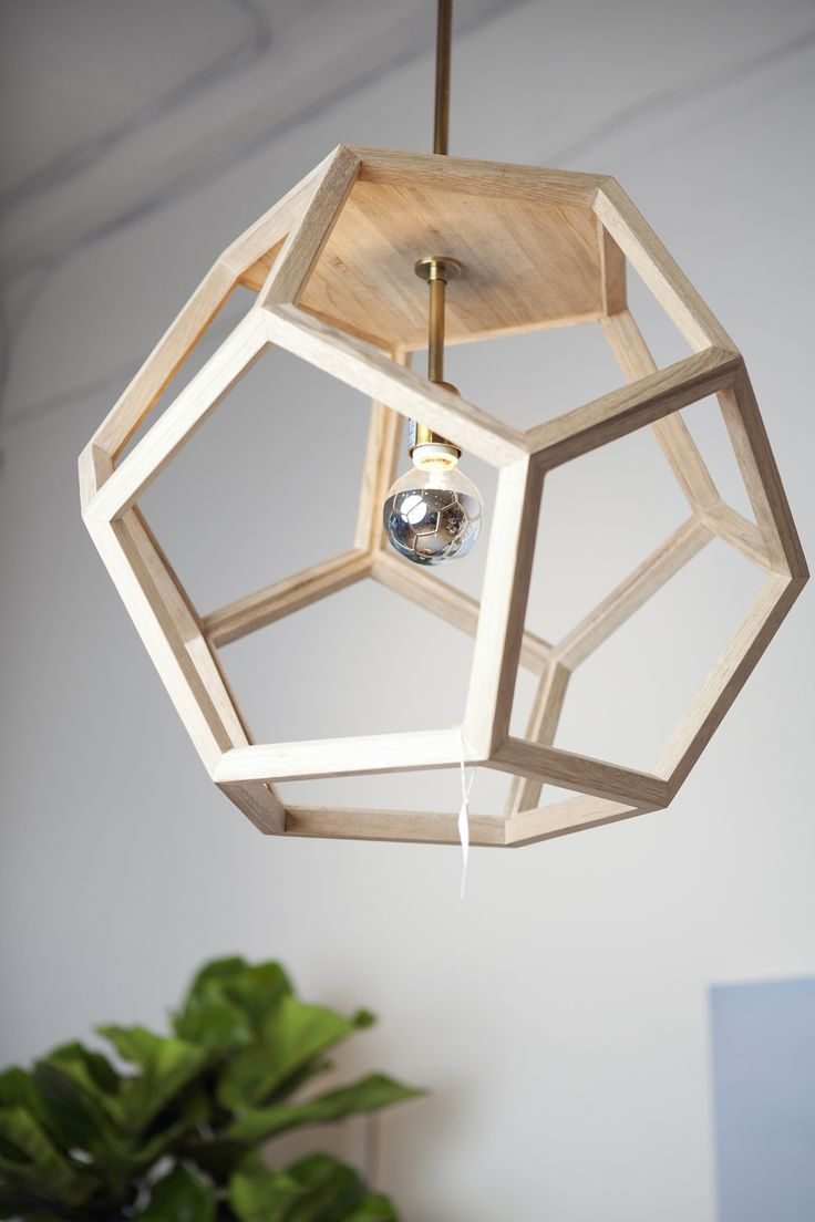 OAK WOOD PENDANT 20″x20″x20″ themill.ca Hexagon wood pendant light fixture with brushed brass.  $ 745.00