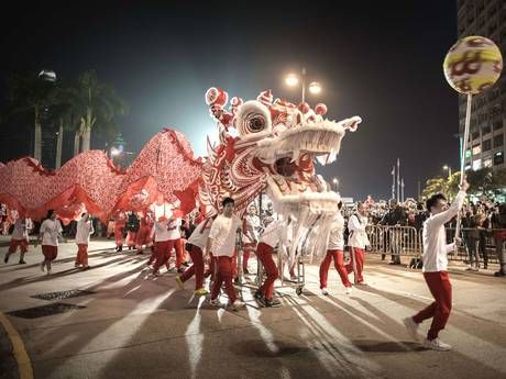 Performers display a dragon dance during a parade in Hong Kong
