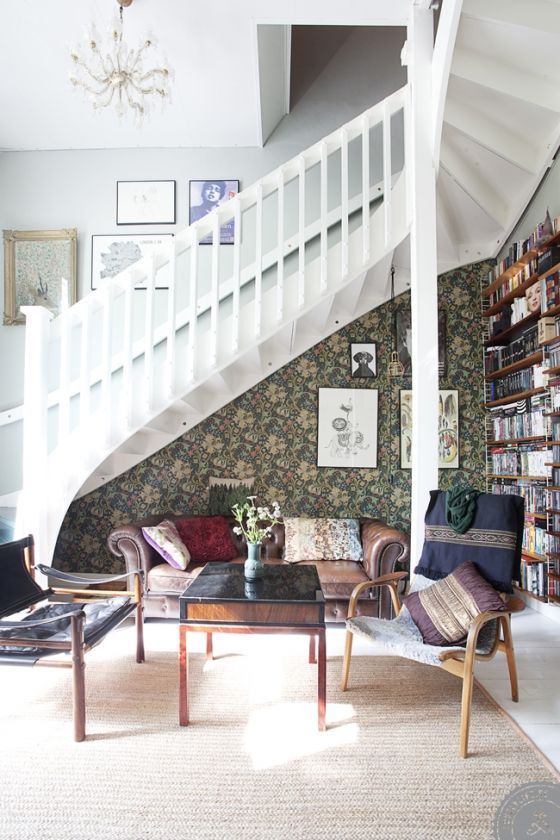 Create a cosy nook or niche under your staircase, but do it with style - like you are walking into a very cosy hotel foyer area that you want to do nothing but plonk yourself down there to be adsorbed into the space