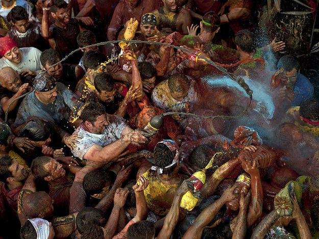 "Cascamorras — Baza, Spain -Every year hundreds of Spaniards cover themselves in grease to reenact the stealing of a famous statue of the ""Virgen de la Piedad,"" which took place over 500 years ago. Best of all, after the greasing, a great big party ensues."