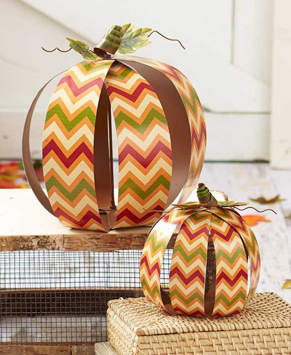Give your home a modern look while decorating with this Set of 2 Printed Harvest Pumpkins. The pumpkins are finished in a popular print with fall colors for use all season. Each is made using metal lo
