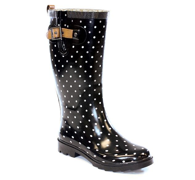 "One of our best selling Chooka boots. This classic black and white polka-dot printed rain boot never goes out of style. Adjustable leather strap and pull-tab for a touch of sophistication. - 14"" Heigh"
