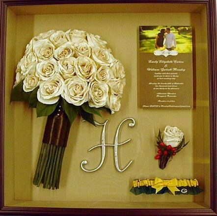 Cute idea! Preserve the bouquet and boutineer and display them in a shadow box with other wedding momentos such as an initial, invitation, photos of bride and groom, brochure, garder, napkin or other wedding decor!