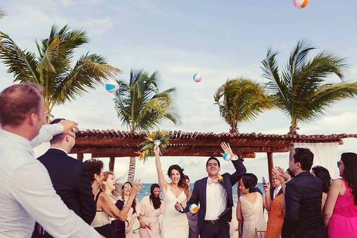 Cancun Destination Wedding at Secrets Maroma Beach, MX  Fun beach ball toss at this gorgeous destination wedding!   Quetzal Wedding Photo