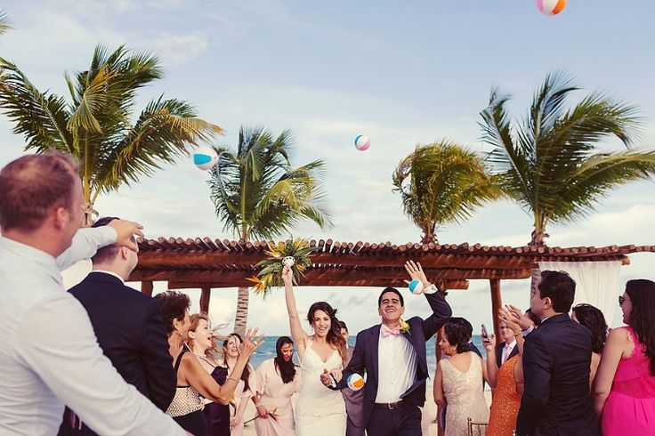 Cancun Destination Wedding at Secrets Maroma Beach, MX  Fun beach ball toss at this gorgeous destination wedding!   Quetzal Wedding Photo