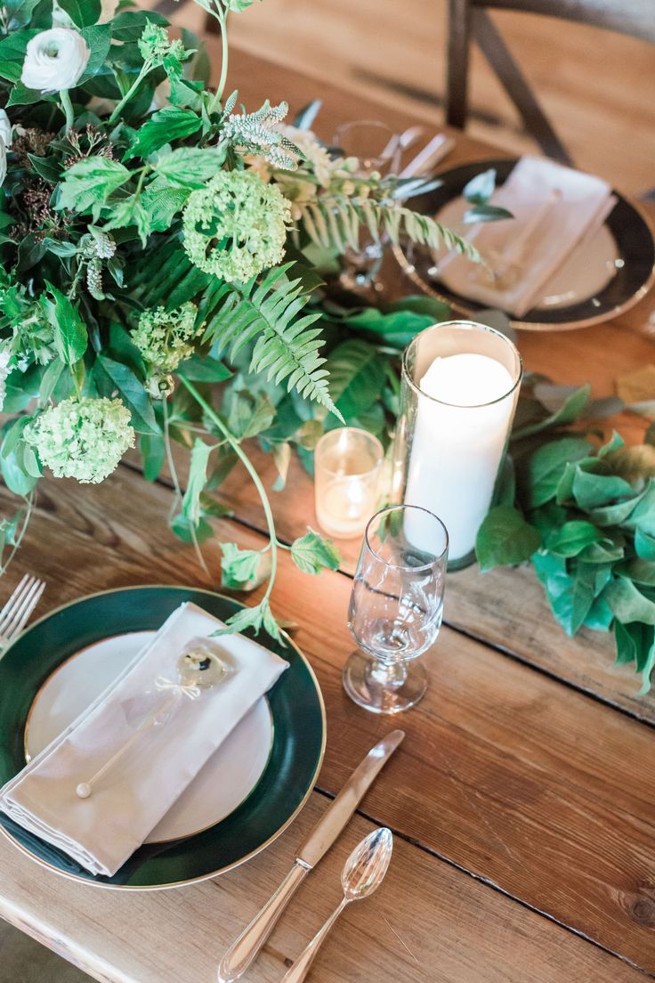 {{Winter wedding farm table with pillar candles and garden style arrangements with snowball viburnum, white ranunculus, and ferns at Bridgeport Art Center in Chicago.}} Photography by Tiffaney Child's Photography http://tiffaneychilds.com/    Flowers by Pollen, pollenfloraldesign.com