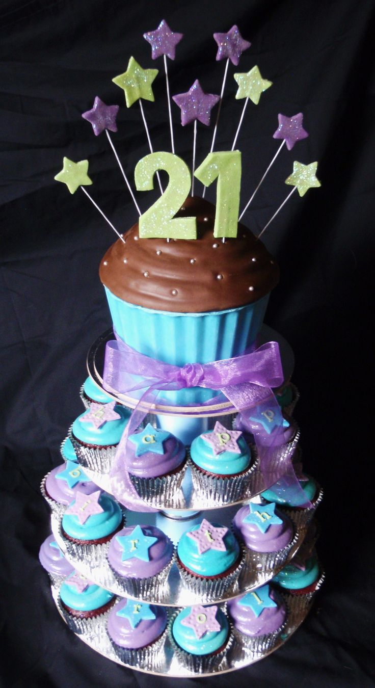 Blue purple and green themed 21st giant cupcake tower for 21st birthday cake decoration
