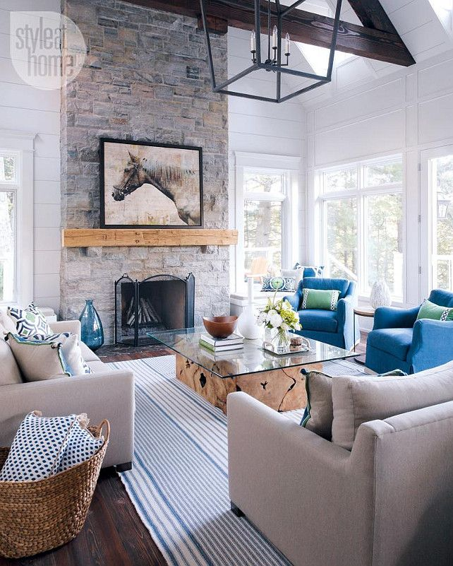 Muskoka Cottage Living Room with Navy and Kelly Pillows from Lacefield. Living Room with tall stone fireplace. #Muskoka #Cottage #LivingRoom  Bachly Construction via Style at Home.