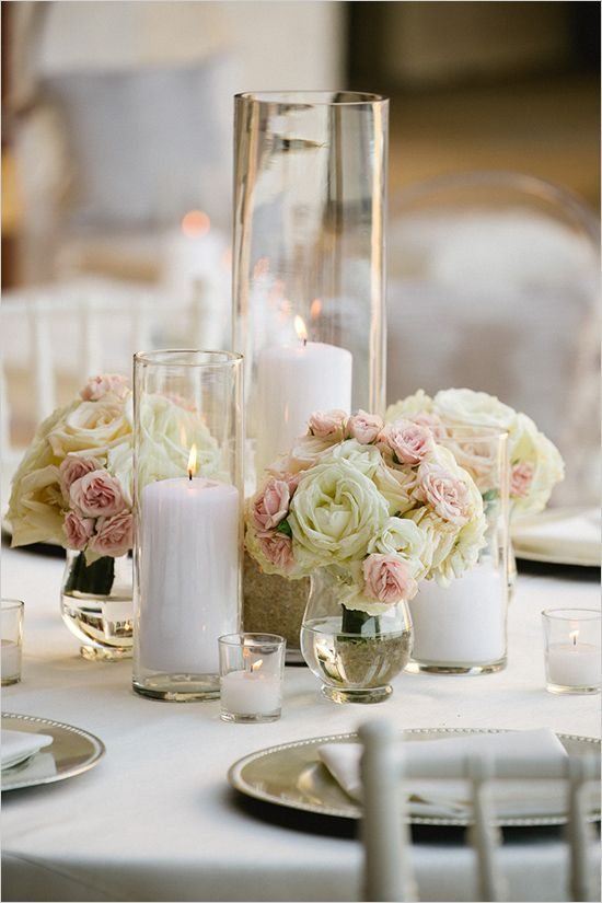 Linda-the vases look like the ones with the candles in them. But I'm looking to put flowers in them. Maybe 2 different sizes per table.