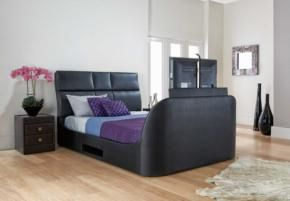 A king-size divan bed, with tv built into the foot end.