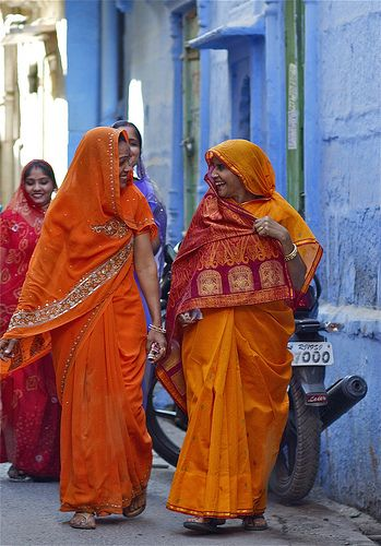 their saris are beautiful and bright!