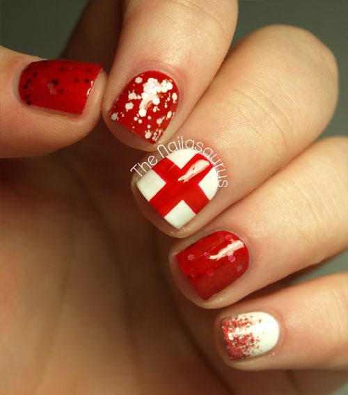 Happy St George's Day! -  Rimmel Heart on Fire and Barry M White as my base colours. On thumb and ring finger, two coats of Aphrodite Lacquers Smolder. Index finger has a coat of Sonnetarium Snowfall and pinkie finger has Sally Hansen Cha-Ching sponged on to the tip. | The Nailasaurus