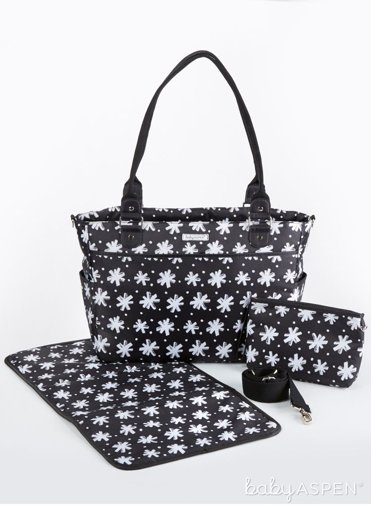 Introducing our new 360 Signature Diaper Bag! It comes with 15 pockets, stroller clips, a wristlet for diaper wipes and a matching changing pad. It is the perfect gift for the new, busy mom. | Baby Aspen 360 Signature Diaper Bag - Black and White Floral