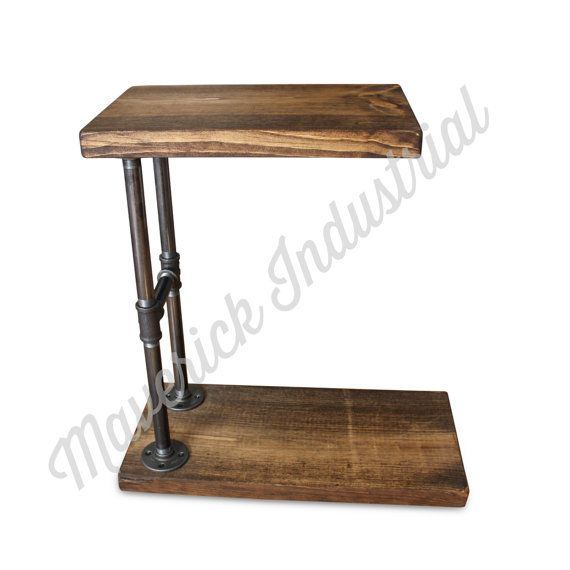 Our Industrial C Table may be simple in design, but its classic and functional too. Made of 100% Natural Pine Wood and Black, Industrial Pipe Fittings in several sizes to meet your needs. This design functions in many ways! ✔Side Table, ✔Laptop Stand ✔Sofa Table ✔Coffee Table ✔Bedside Table ✔TV Tray  Extremely sturdy but still lightweight enough to easily move across your any type of floor. Angle the table under your sofa, recliner or your bed, then move it out of the way once youre…