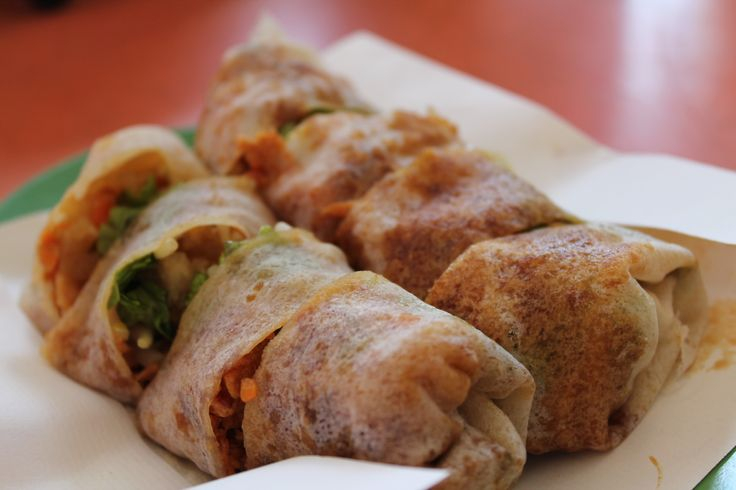 Our recipe of the week is from Singapore. Try your hand at cooking Nyonya Popiah 薄饼 (Fresh egg vegetable rolls). This is a little more detailed to cook, but a great alternate for fried spring rolls. #NyonyaPopiah #Singapore #Recipe For more info: feasttotheworld.com/2012/06/unsung-spring-roll-singapore-nonya.html: Nyonyapopiah Singapore, Singapore Recipes
