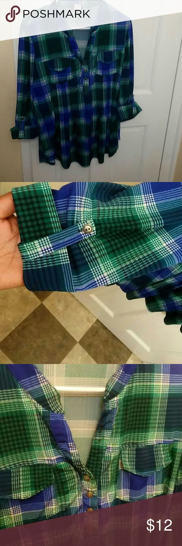 Blue and green flannel shirt It is a blue, green,black, and white flannel. It is a button up but the top is open. Basically room for a little cleavage ladies!!💚💙 Cocomo Tops Blouses