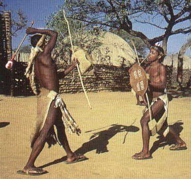 Zulu warriors fighting with sticks