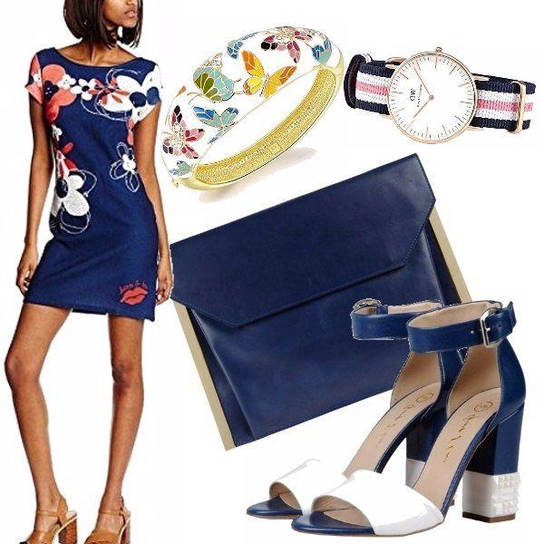 Il vestitino perfetto per un caldo pomeriggio, ben si abbina ai sandali bicolor col tacco grosso, alla bustina raffinata. A completare l'outfit abbiamo il bracciale smaltato e colorato e l'orologio minimal chic!