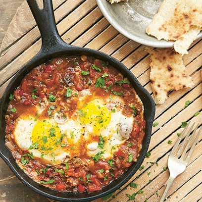 Egyptian shakshuka baked eggs recipe. For the full recipe, click the picture or visit RedOnline.co.uk