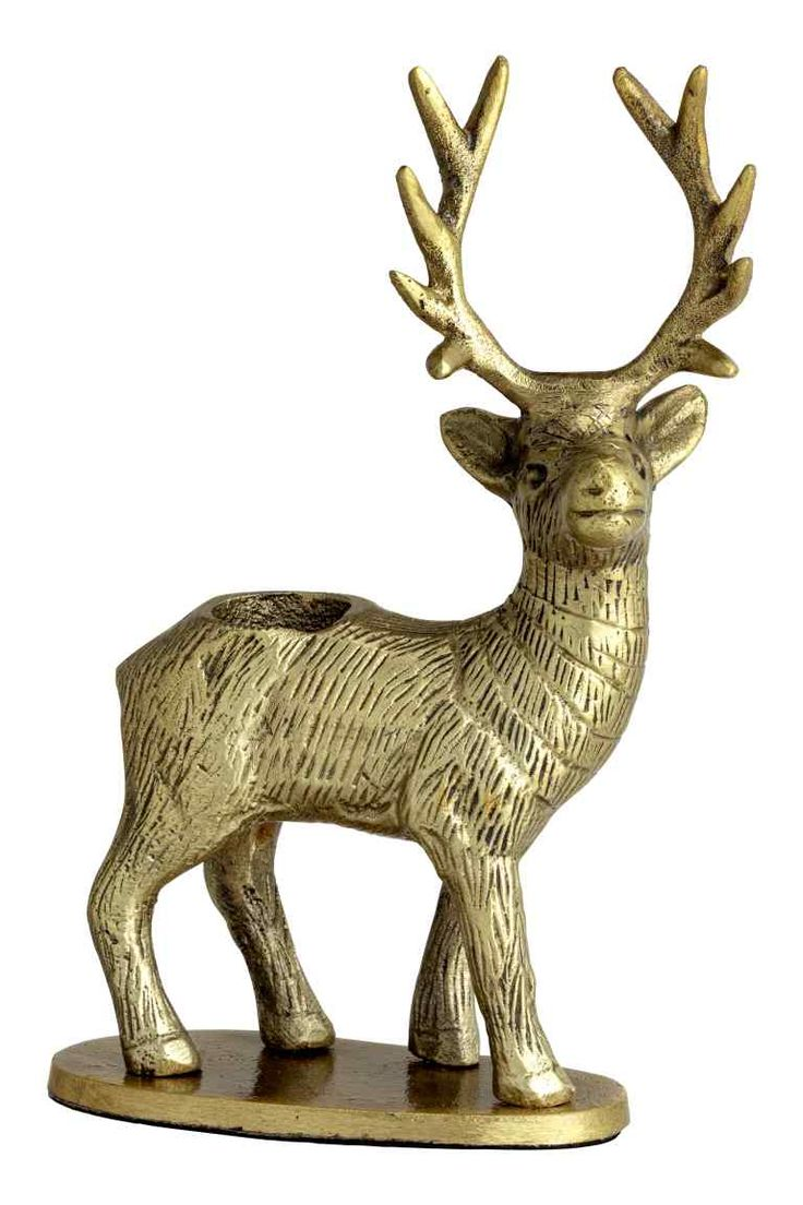 Antiqued metal candlestick in the shape of a reindeer. Diameter of candle holder 2.2 cm. Size of candlestick 4.5x10x17 cm.