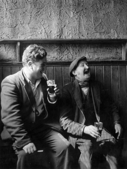 Irish playwright and author Brendan Behan shares a joke in a Dublin pub.