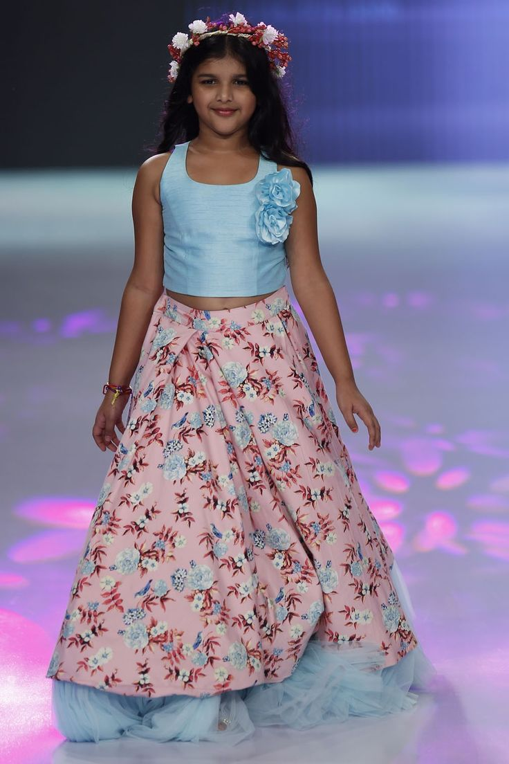 For the little lady. A dress of allure and captivity for the little queen of your heart. This combination of blouse and skirt style with ruffled net lining gives it a royal gown-like feel. Experiment a little with her style by using prints and pleats; this gorgeous floral all-over-printed skirt is the way to start. #stylemylo #kidsfashion #kidswear #designerwear #kidsoutfit #newcollection #indianwear #onlineshopping #babyboy #babygirl #rakshabandhan