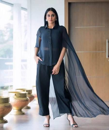 Regina's Dramatic Cape Look... Actress  #ReginaCassandrak by Ridhi Mehra. It seems that the cape trend is everywhere from ethnic to western wear. Smokey eyes, flared pants and oh that drape! Adds all major drama to her look... Own the look at https://www.estrolo.com/whatstrending/reginas-dramatic-cape-look/