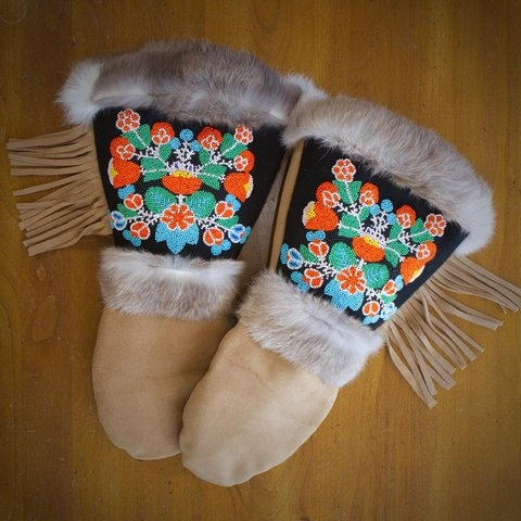 Hand-stitched, hand-beaded and totally to-die-for Astis Mittens. Because: If ever there were an opportunity to blow two hundred bones on a pair of mittens, now's your chance. Modeled after the traditional mittens of the Cree Indians, these puppies will last a lifetime. Wear them skiing. Mushing. Igloo-building. Walking around Boston when it's really bloody cold out. 195 dollars