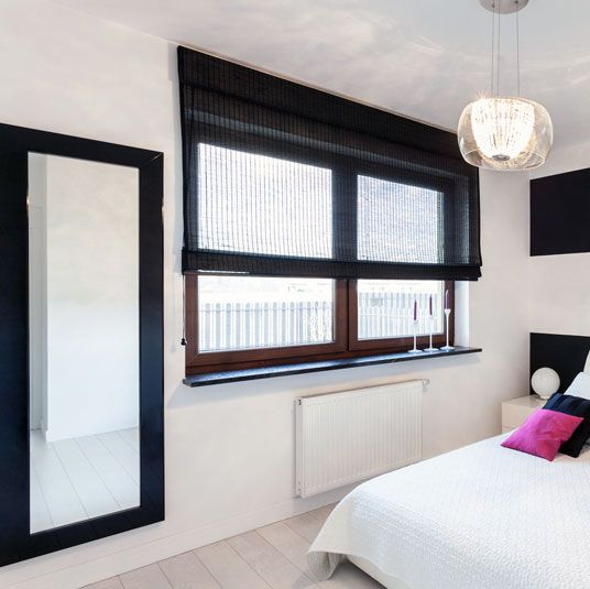 Make Photo Gallery Bring some contrast to pristine white walls with a black framed wall mirror