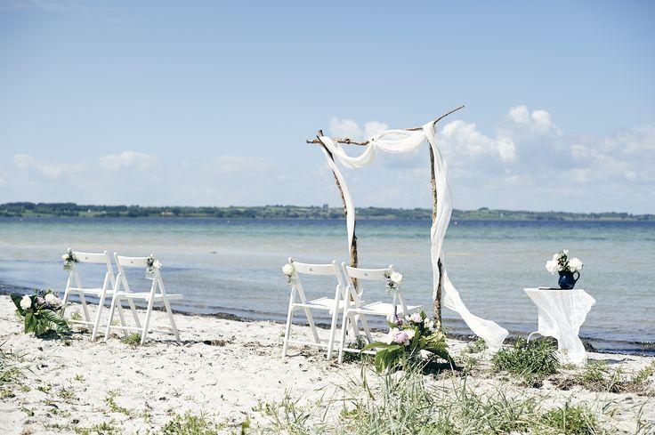 intimate beach wedding in Denmark with www.danishislandweddings.com Photo by Kimmi Martin