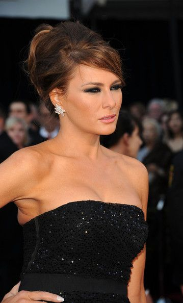Melania Trump Classic Bun - Melania Trump's pulled back bun hairstyle showed off her brunette tresses at the 83rd Academy Awards.