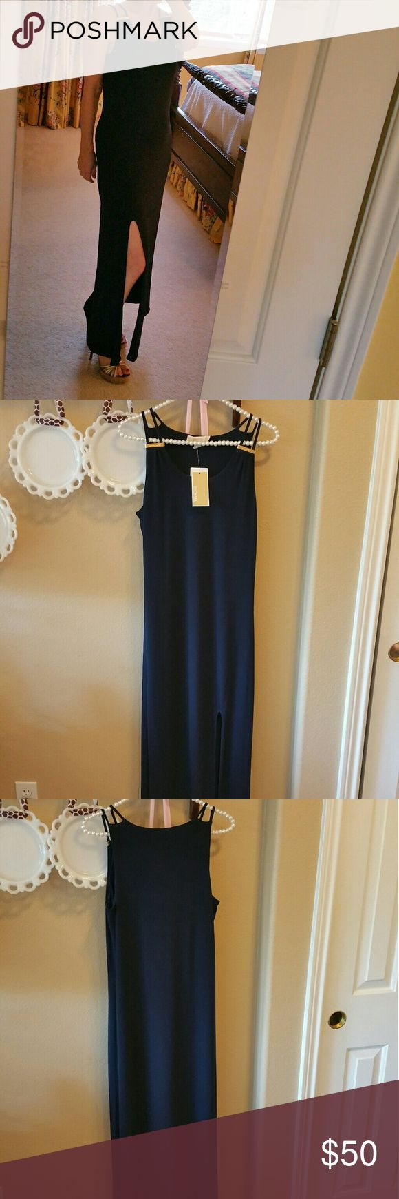 NWT MICHAEL KORS NAVY MAXI DRESS WITH GOLD ACCENTS This NWT MICHAEL KORS NAVY MAXI DRESS WITH GOLD ACCENTS is form fitting and is flexible enough to wear shopping during the day or dressed up for a night out on the town. Michael Kors Dresses Maxi