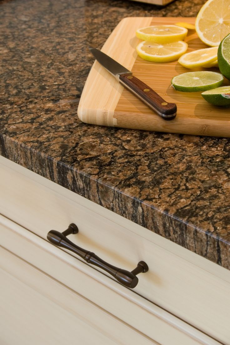 Use dark hardware to bring in the dark colors from the granite? Ours is not this dark but it is brown and has black flecks.