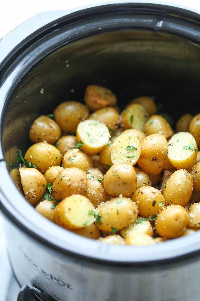 Slow Cooker Garlic Parmesan Potatoes - Crisp-tender potatoes with garlicky parmesan goodness. It's the easiest side dish you will ever make in the crockpot! from damn delicious