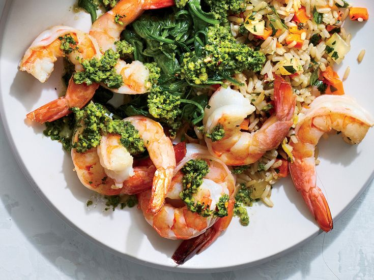 Pan-Seared Shrimp with Walnut and Herb Gremolata   Fresh herbs and lemon make a bright, tasty topper for succulent shrimp. Fish and shellfish are excellent sources of protein for fewer calories than most meat. Paired with spinach and rice pilaf, this weeknight-friendly main comes together in just 15 minutes.