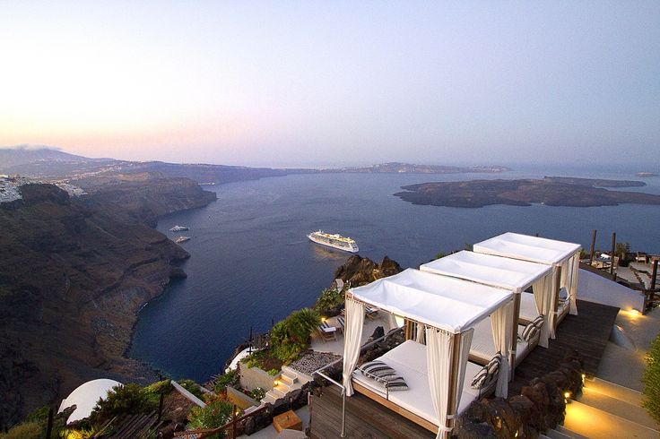 Poolside bar & restaurant - enjoy your meal or drink while admiring the view of Santorini island!