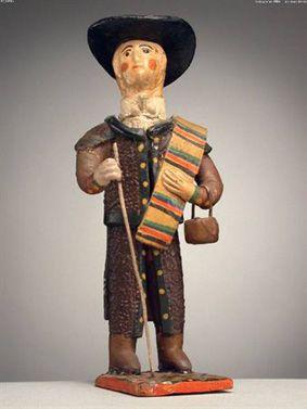 Pastor de manta ao ombro, com tarro e cajado (16,3 x 7 cm). Autor desconhecido (séc. XX). Museu Nacional de Etnologia, Lisboa.