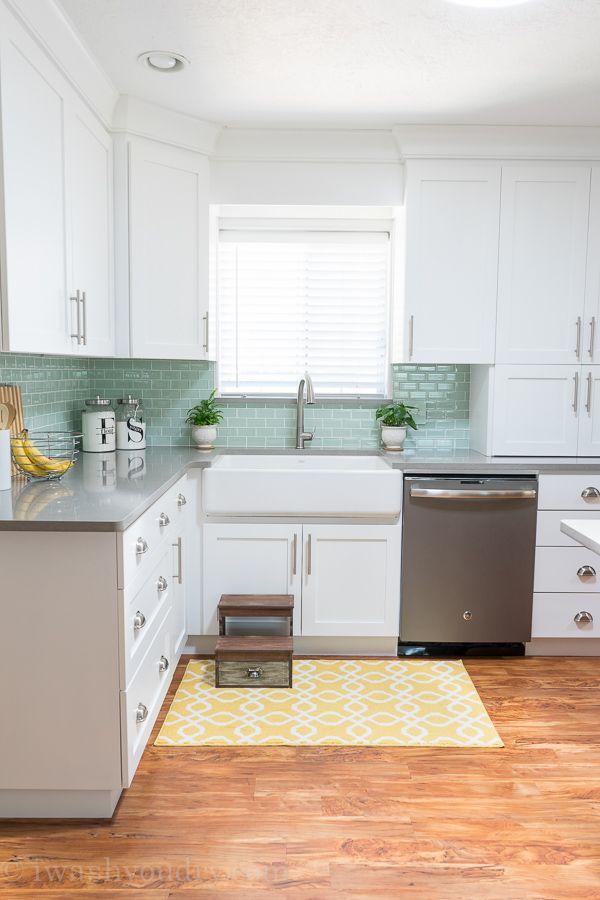 White Cabinets, GE Slate Appliances, Nickel Satin Cup Pulls, Gray Quartz  Countertops,