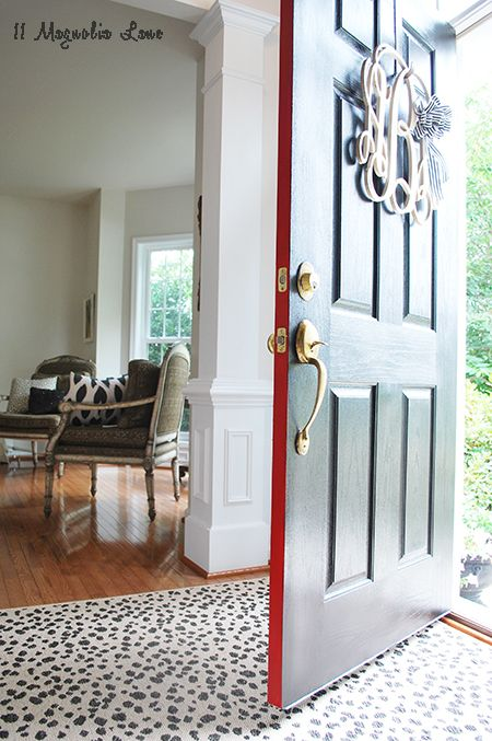 New home tour at 11 Magnolia Lane--builder-grade house gets lots of fun touches like this pop of red on the front door.