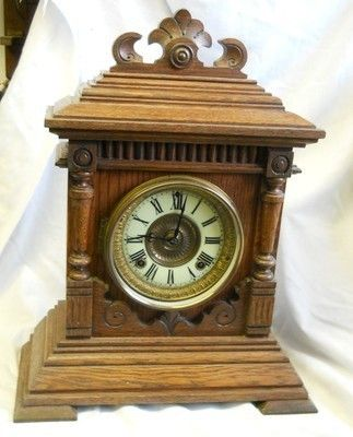 ansonia usa mantle clock,good working order and supplied with pendulumn and key,BUT the bezel is a later replacement,clock stands at 17 inches tall,,width 13 1/2 ,depth 6 inch For courier quotes of u