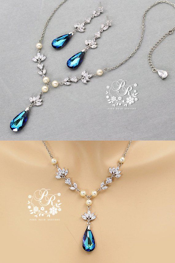 e53e911d3 This Elegant necklace and earrings featuring 24x12mm Teardrop Swarovski  Bermuda Blue Crystal and the AAA Zirconia