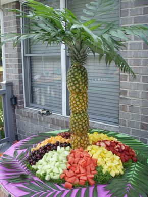 Pineapple palm fruit tree: Cut top and bottom of pineapple. Cut out the fruit leaving some still attached to the shell. Add in skewers to hold together. Top with leaves and ta-da!