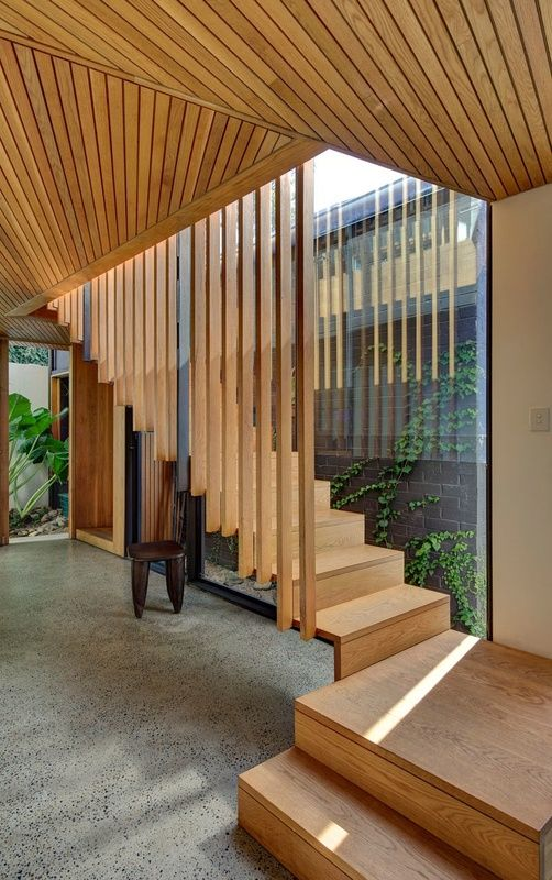 Suspended timber stairs in the Balmain House by Fox Johnston Architects
