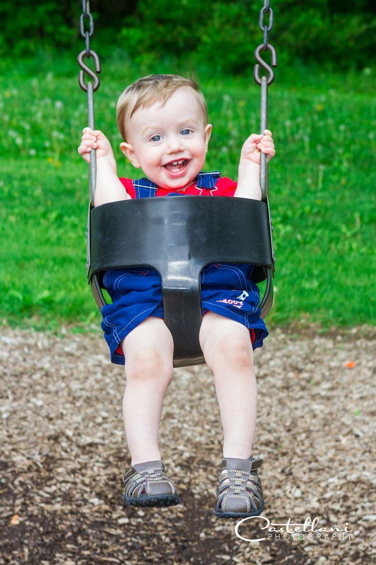 baby-swinging-on-swing-big-smile-boyce-park-plum-pa-family-portraits