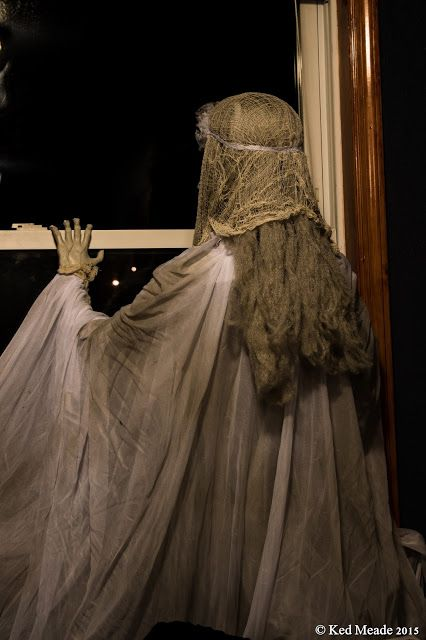 ghost in the window used in an upstairs room with awesome back lighting creepy halloween decorationshalloween