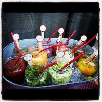 I like the little signs on the popsicle sticks... not necessarily these toppings, but pickles etc...  keep it simple.