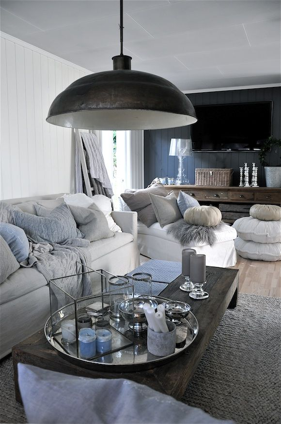 Love the light blue/gray/wood/metal.  Inspiration for our great room