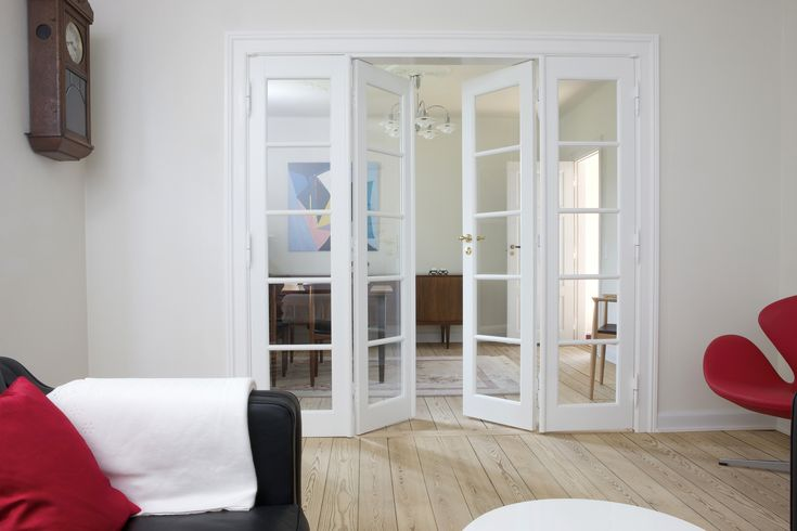 A four-winged door, mounted into a classic Danish dwelling with a twist of modern design. The door has through-going divisions, that seperates the glass. A true nordic design approach.   The doors are made by www.vahle.dk