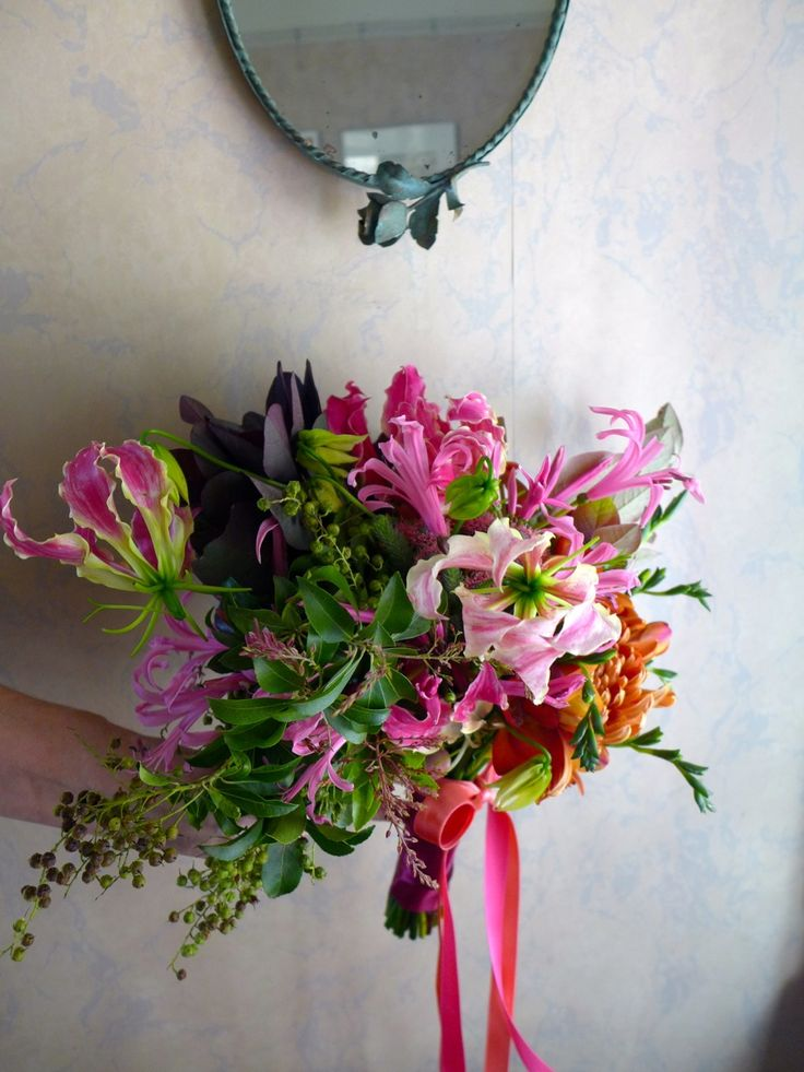 Bridal bouquet with autumn pinks & oranges - trailing ribbons