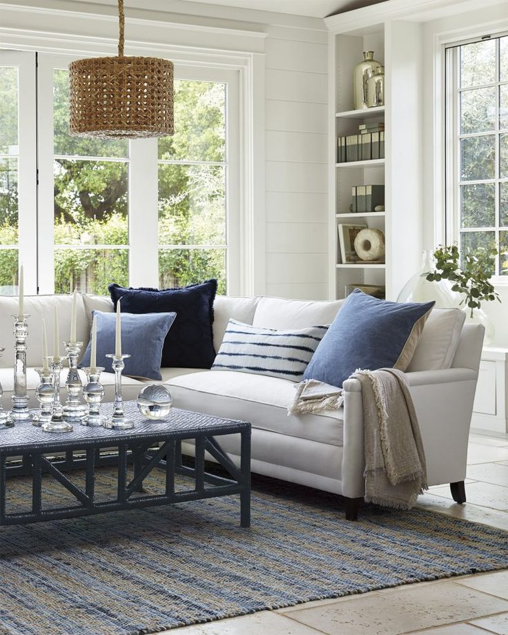 Wonderful blue and white room that has a coastal feel without screaming COASTAL! Dozens of fab coffee tables. Love the white sectional too from Serena and Lily.